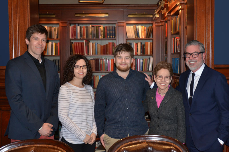 Vincent O'Leary, center, celebrates his Truman Scholarship alongside President John Fry.