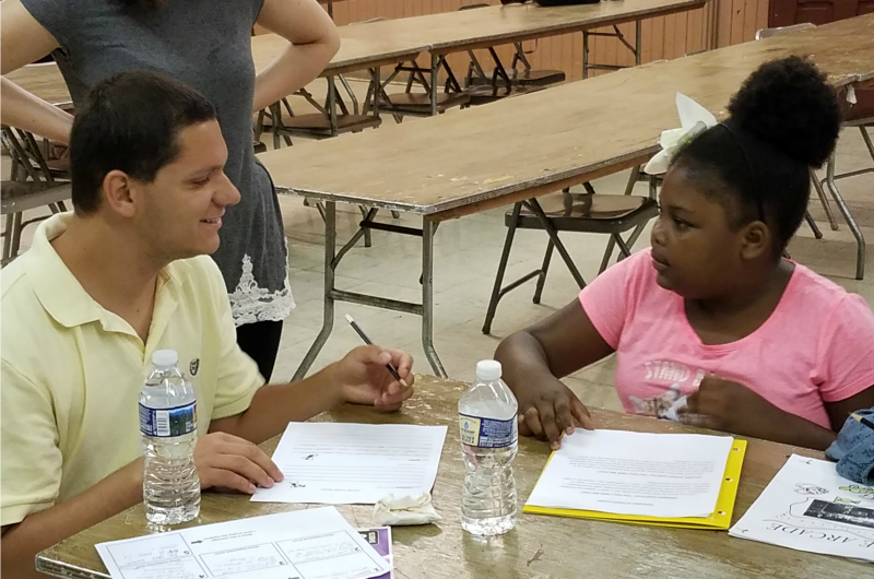 Hayden O'Rourke works with a student at Drexel's Summer Literacy Camp.