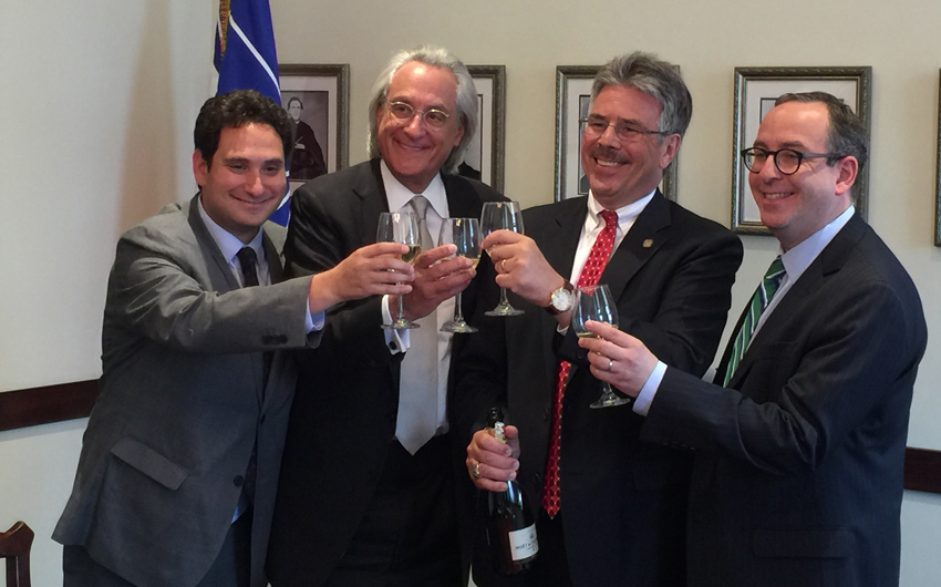 Zac Kline, '12 (Law), Tom Kline, Duquesne President Ken Gormley, Dan Filler toast to celebrate the path-breaking announcement.