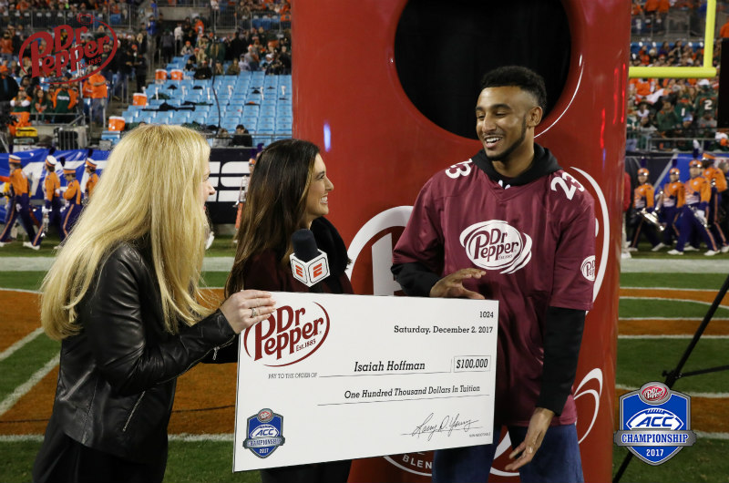 Isaiah Hoffman accepts an extra-large check after winning $100,000.