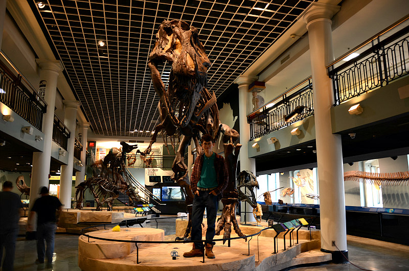 Kevin Sievers stands beneath the Academy's intimidating Tyrannosaurus rex.