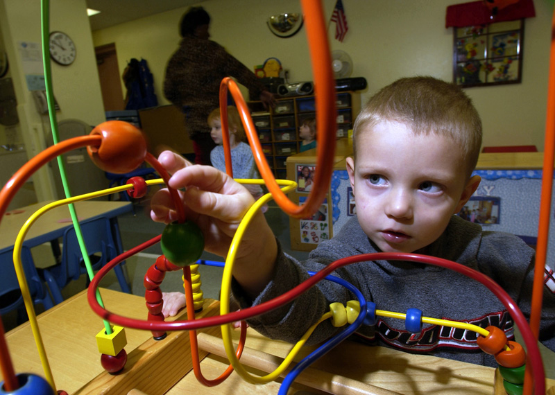 A child playing with a toy at a daycare.