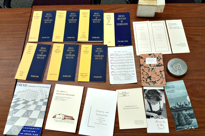 A sampling of the memorabilia stored in the cornerstone box found in the Korman Center that is now being stored in University Archives.