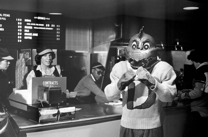 A Drexel dragon holding a burger at the Dragon's Den in 1979. Photo courtesy University Archives.
