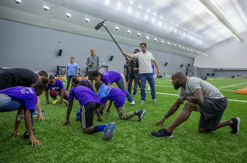 Eagles safety Malcolm Jenkins stretches with the Young Dragons.