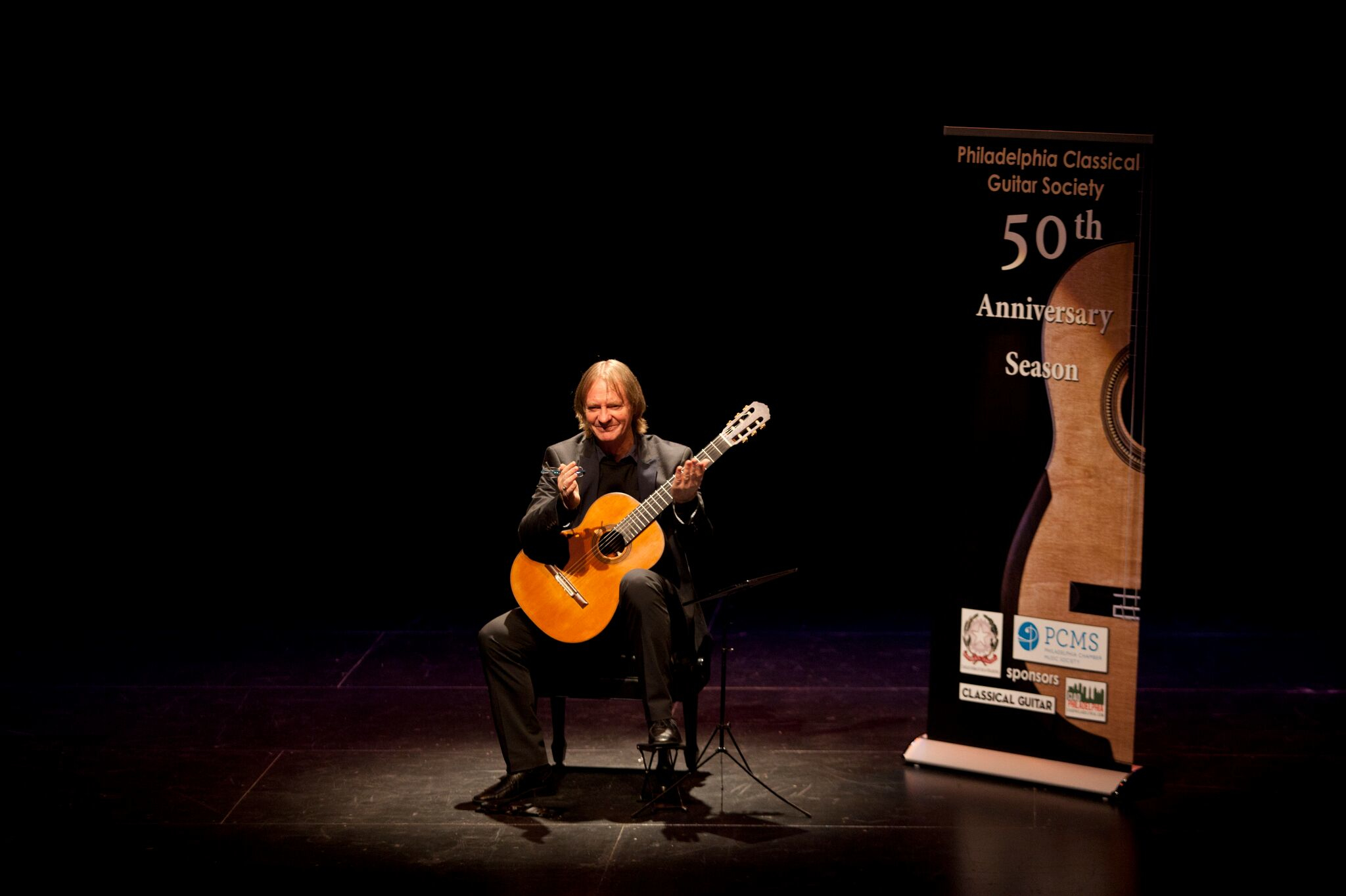 Classical guitarist David Russell playing at Drexel University's Mandell Theater this past spring, which Zillmer helped make happen.