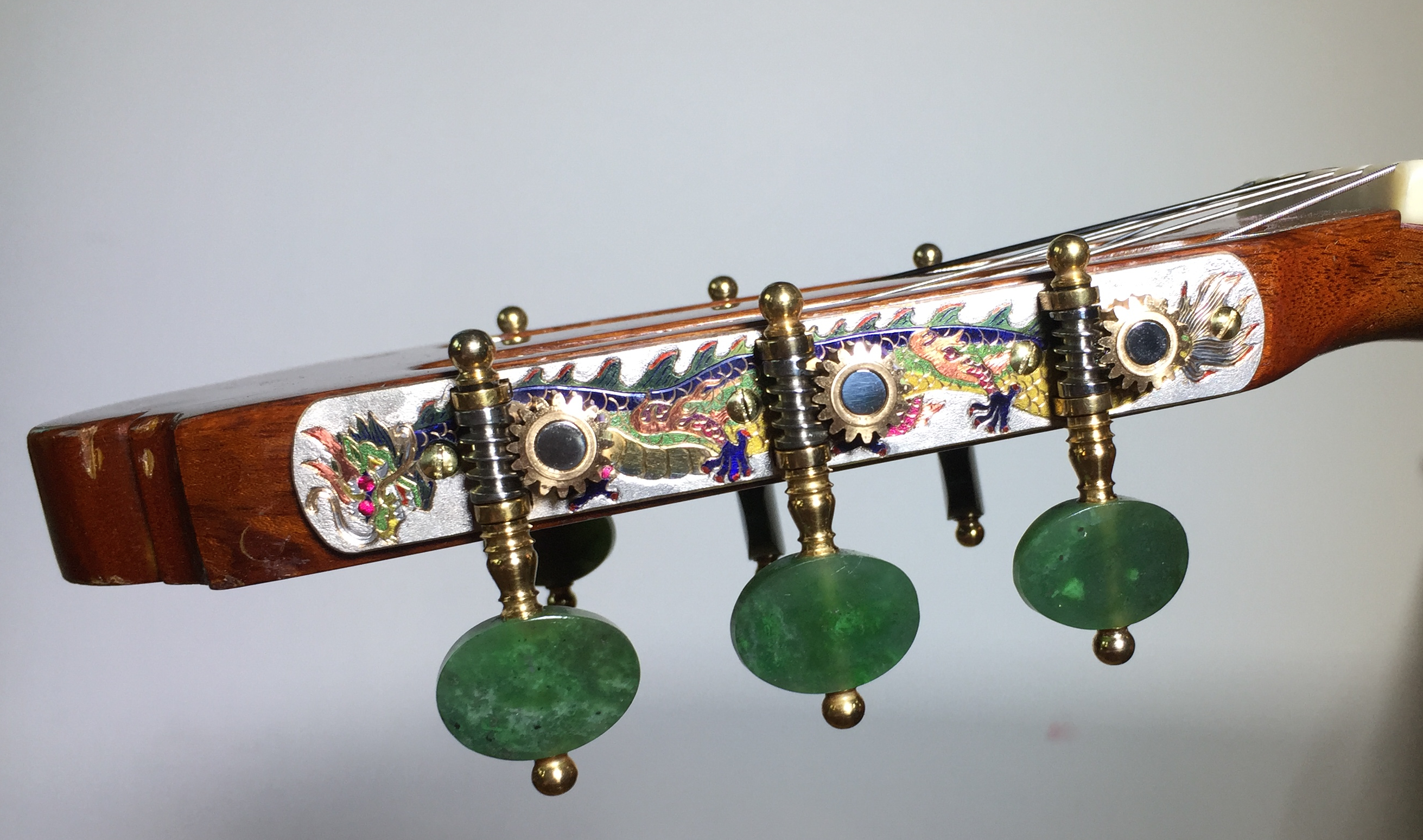 Zillmer retrofitted this flamenco guitar with special custom tuners designed specifically for him — check out the two Chinese-style dragons along with jade tuners.