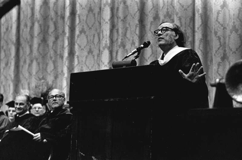 Isaac Asimov speaking at the 1976 Drexel University graduation ceremony. Drexel President William Hagerty, left of the podium, looks on. Photo courtesy University Archives.