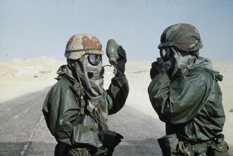 Study identifies an enzyme inhibitor to treat gulf war illness the gulf war 1991 two us soldiers drink from water bottles while wearing protective gear for a training exercise in saudi arabia before the start of sciox Gallery