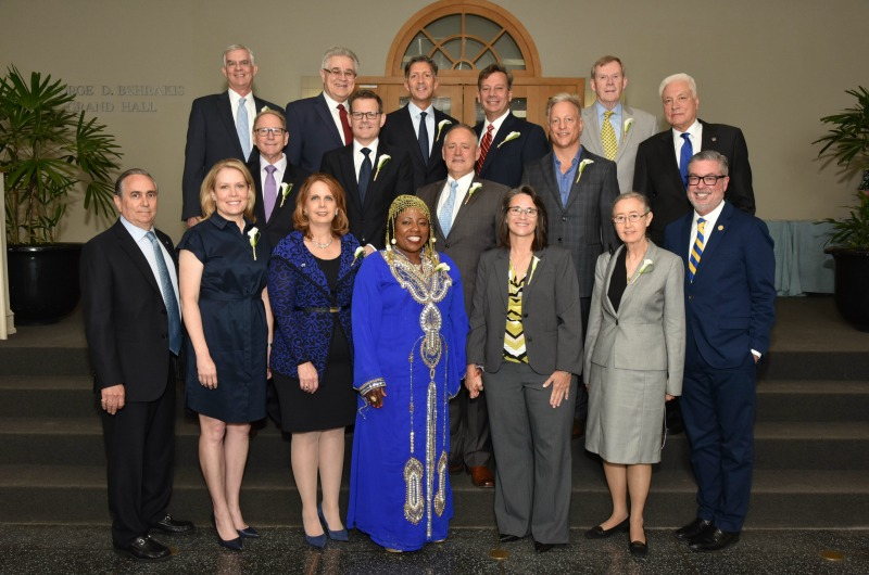 The 14 members of the 2017 class of the Drexel 100 pictured with other Dragons at the ceremony. Top row, left to right: Joseph Grimes; Leonid Hrebien; Richard A. Rose, Jr.; Alfred Altomari; and Thomas Matthews. Middle row: Henri Levit; Clifford Hudis; Craig Sabatino; Michael Baum; and Chair of the Board of Trustees Richard A. Greenawalt. Bottom row: Chair of the Drexel 100 David R. Geltzer; Christine McKendry Andrade; Kathleen Chimicles; Rita K. Adeniran; Lisa Anne Forsyth; Libby Fleisher Wilson; and President John Fry.