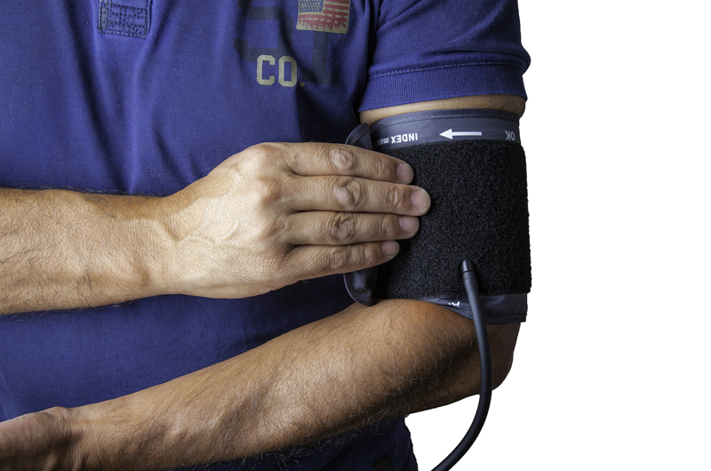 A patient wearing a blood pressure cuff.