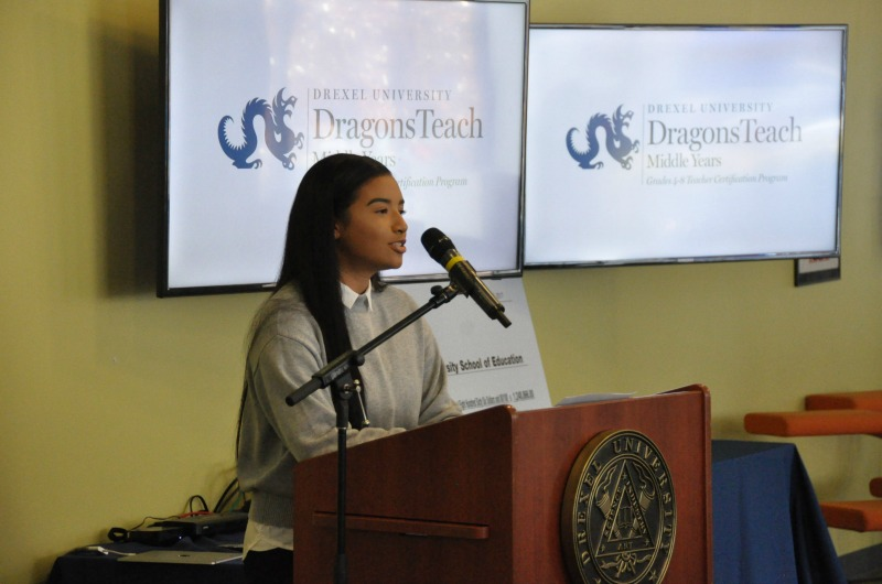 Aja Sor speaks at a press conference announcing a $1.2 million grant for the DragonsTeach Middle Years program.