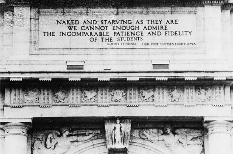 "This image from The Triangle's 1987 joke issue was published with the caption ""The Main Building gets a facelift. After sitting on a Philadelphia street corner for 96 years it is now being restored. In a valiant effort to improve the image of Drexel University, Dr. Gaither has immortalized the above quote in stone."""