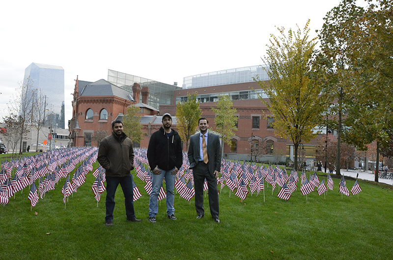 Drexel student veterans Joy Panicker Jr., Peter Majerick IV and Emery Mako (from left to right) stand in front of the flag installation.