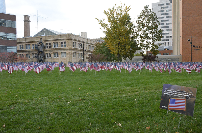 The view of the flag installation from outside of the Gerri C. LeBow Hall.