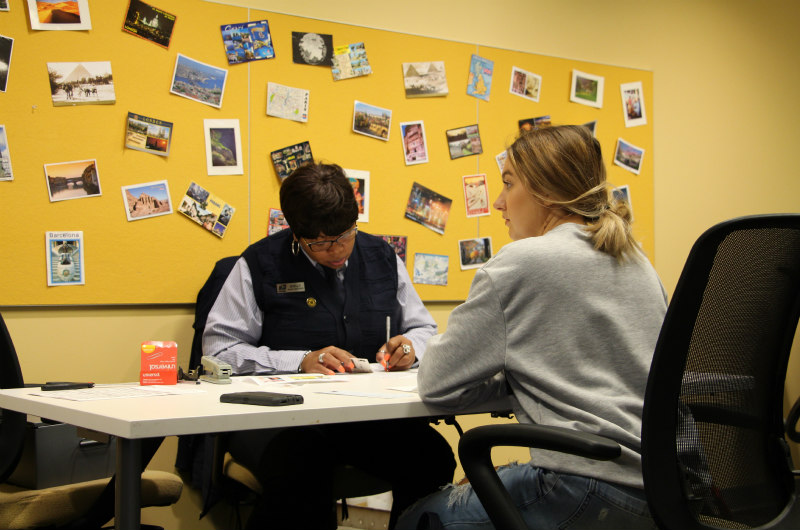 A Drexel student gets her passport at Passport Day