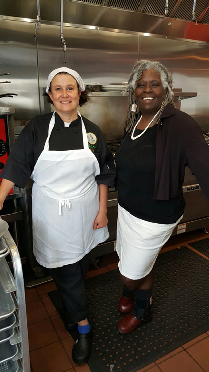 Marjore Felton standing with Valerie Erwin in the kitchen of the EAT Cafe