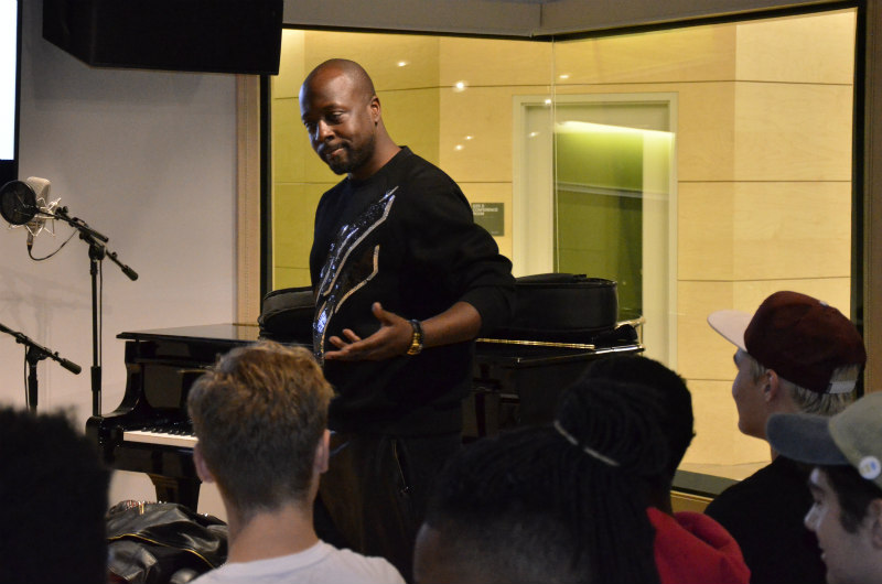 Wyclef Jean performs an a cappella rap for music industry students.
