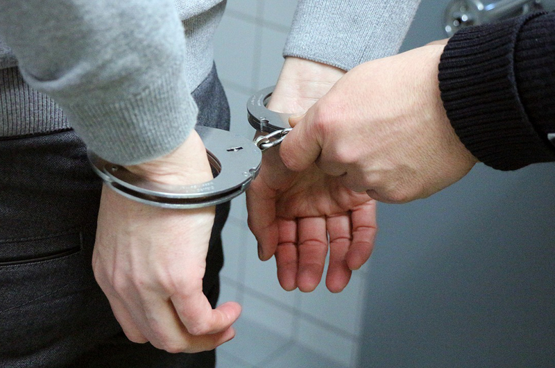 A person being handcuffed