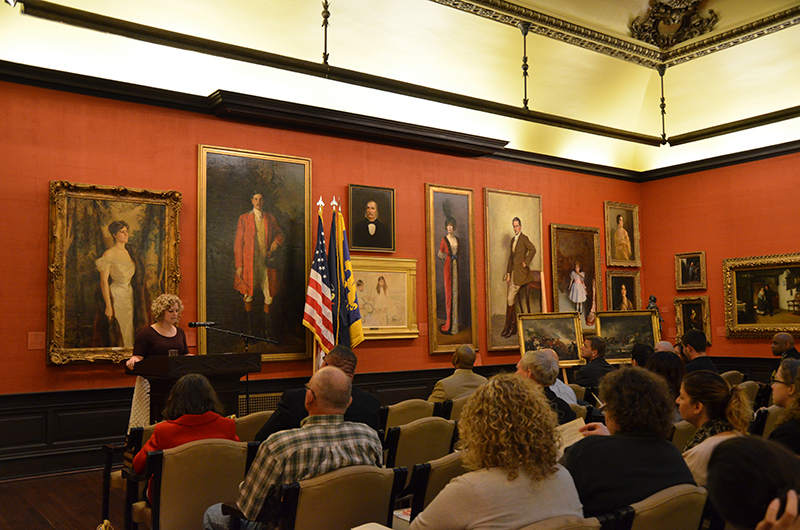 Lynn Clouser, director of The Drexel Collection, speaking at an event in the A.J. Drexel Picture Gallery for Veteran's Day.