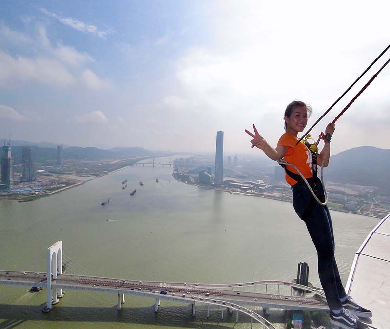 Kathy Chen balances on the edge of the Macau Tower, an intimidating 233 meters above ground.