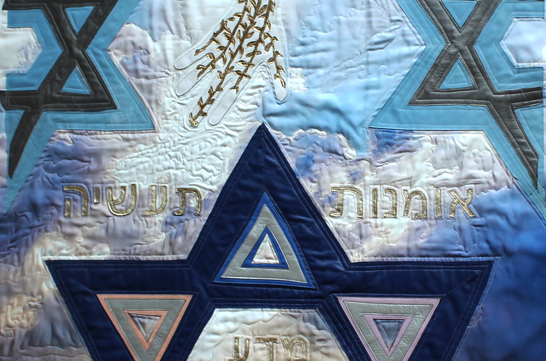 Artwork that depicts golden hand of God and blue star of David