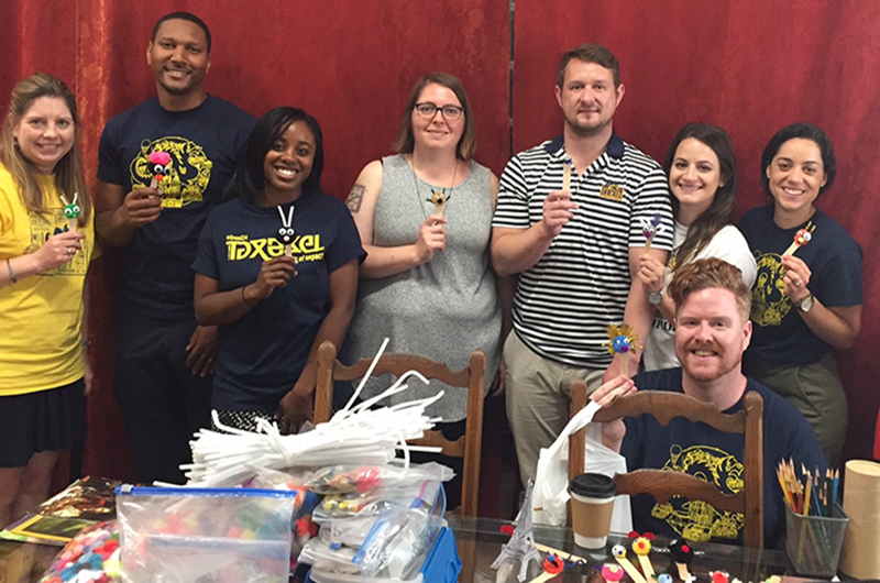 Drexel Admissions professional staff volunteering at Arts Sphere, Inc.