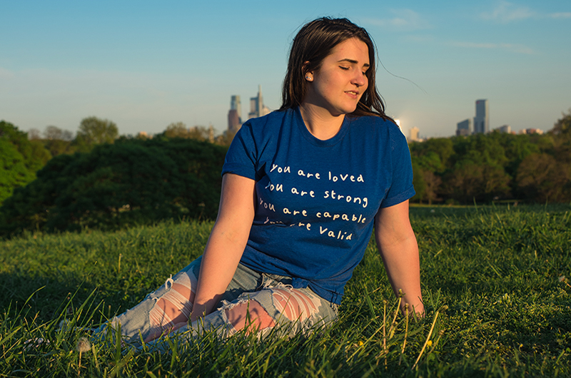 Gabby Frost in a Buddy Project shirt she designed. Photo credit Lexi Shannon.