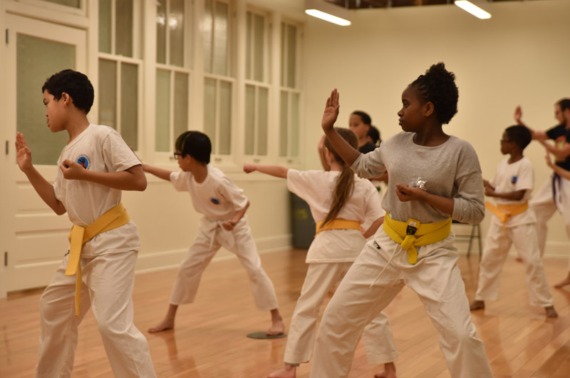 kids from the West Philadelphia area taking a karate class at the Dornsife Center