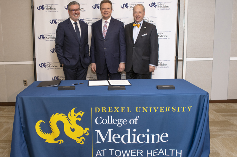 Photo of Drexel President John Fry, Tower Health President and CEO Clint Matthews and Dean of Drexel's College of Medicine Daniel Schidlow at the signing ceremony
