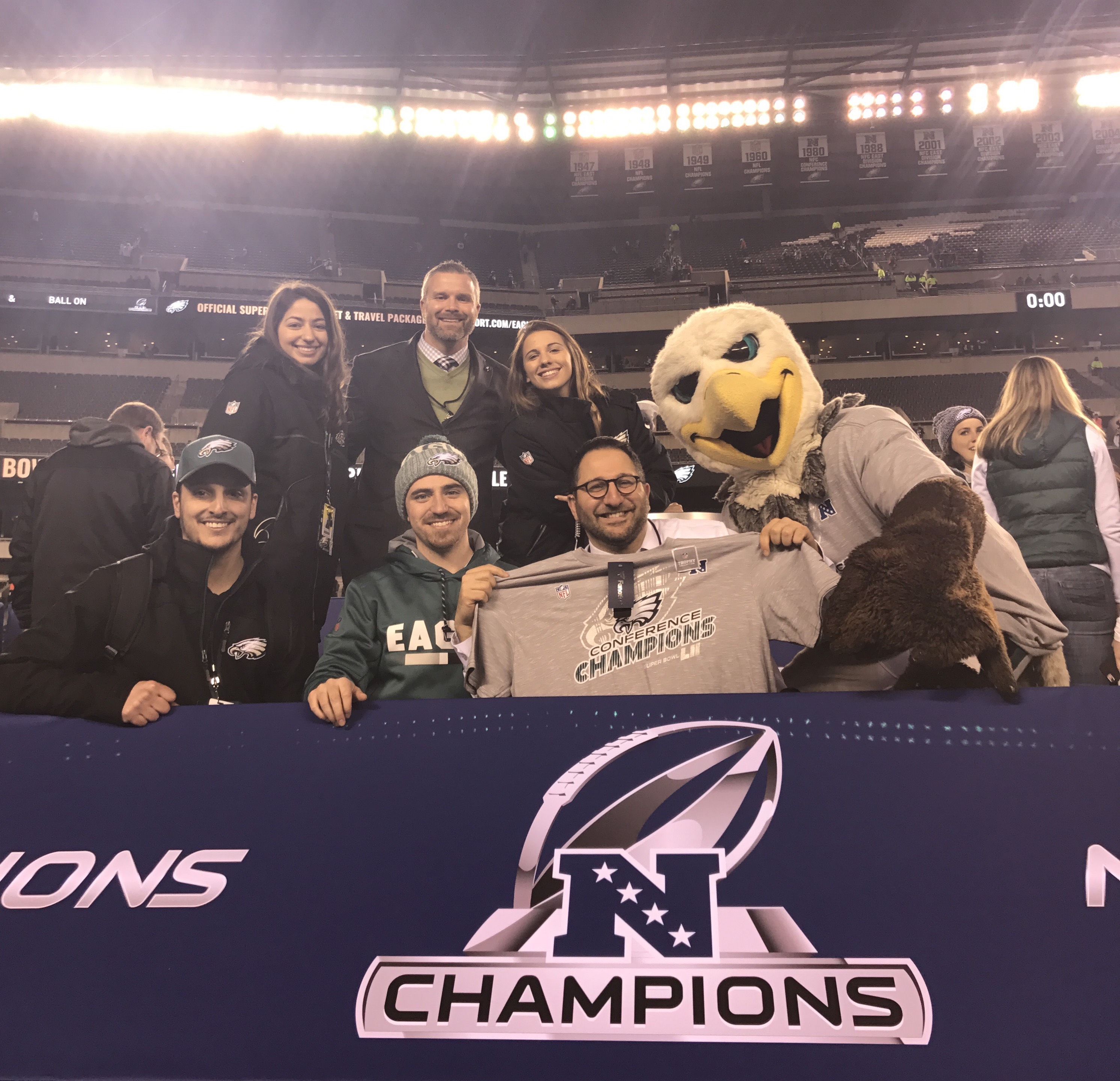 Victoria Louca, top left, celebrating with Swoop and the Eagles' marketing team at Lincoln Financial Field.