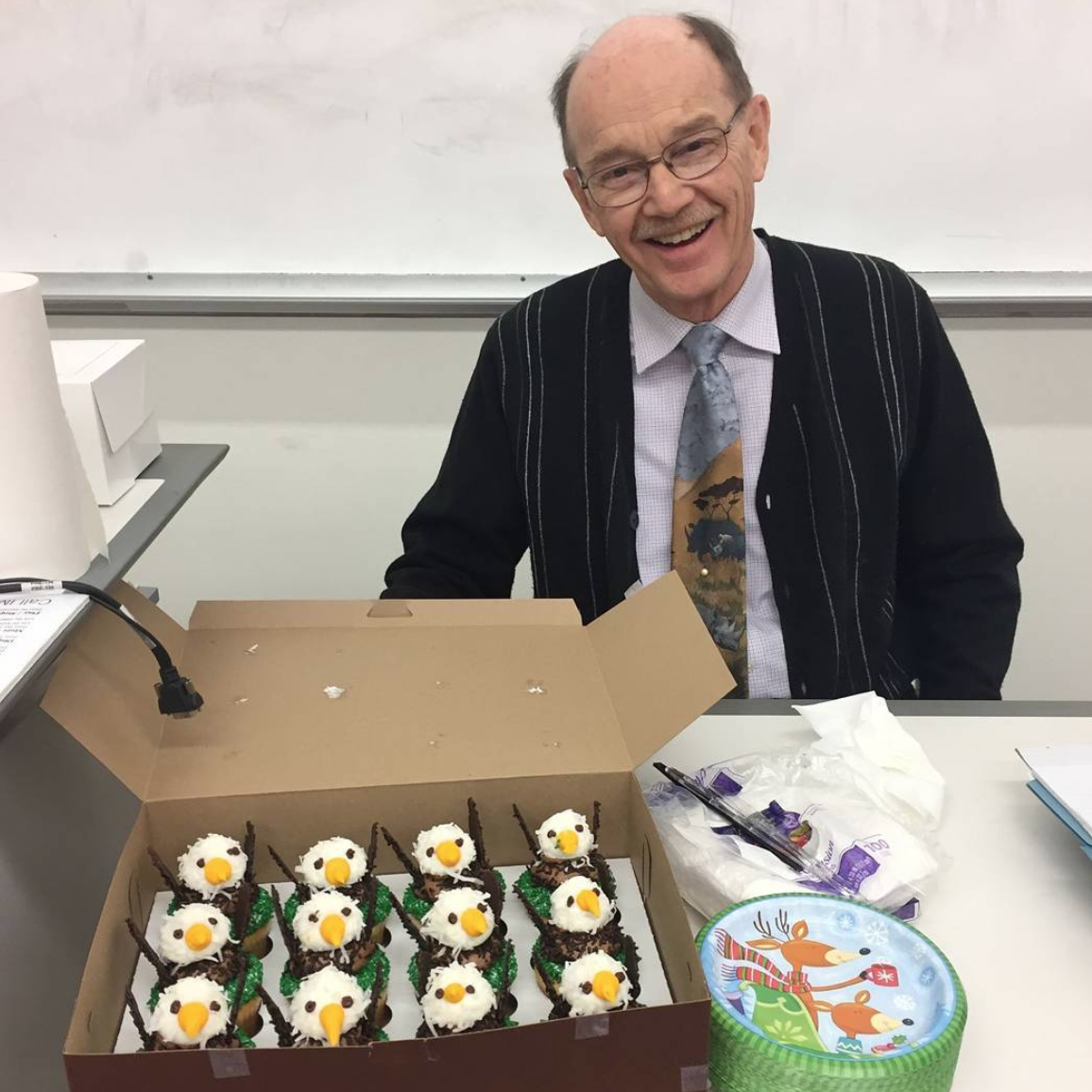 "James Spotila, PhD, L. Drew Betz Chair Professor in the College of Arts and Sciences' Department of Biodiversity, Earth & Environmental Science, with the Eagles cupcakes he brought to his ""Endangered Species Conservation"" class."