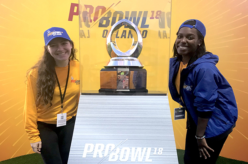 Samantha Bickel, left, and Kamille Watson, right, with the Pro Bowl trophy.