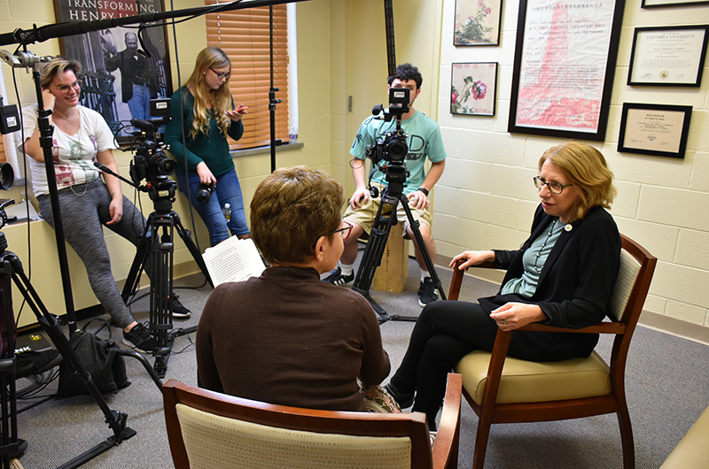 "Dean Paula Marantz Cohen, left, and Roz Chast are filmed by Drexel students Lucy Moroukain, Laurel Murr and Louis Togna (L-R) for an episode for ""The Drexel InterView."""