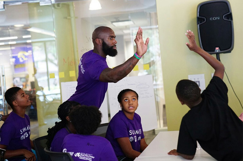 Malcom Jenkins interacting with students at Young Dragons camp in 2016.