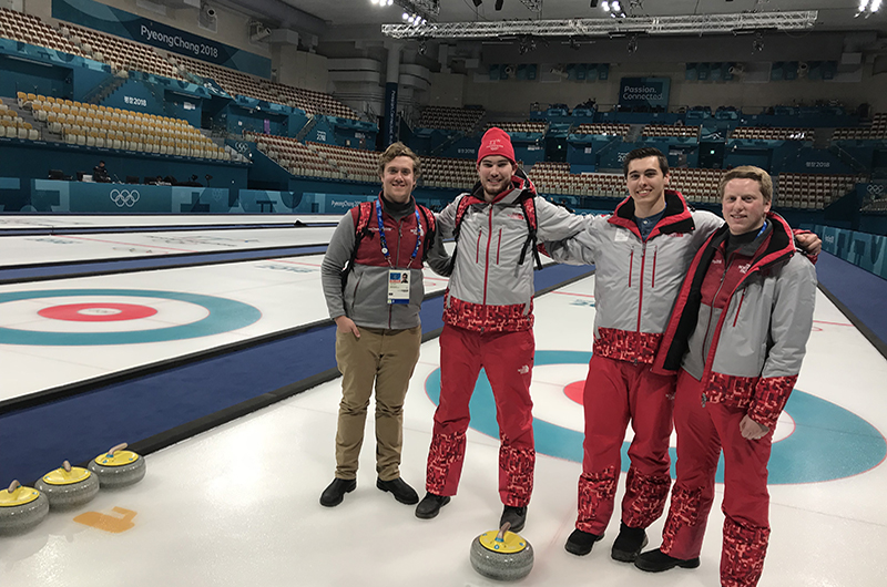 Ryan Roe, left, with coworkers in the curling arena at the 2018 Winter Olympics.