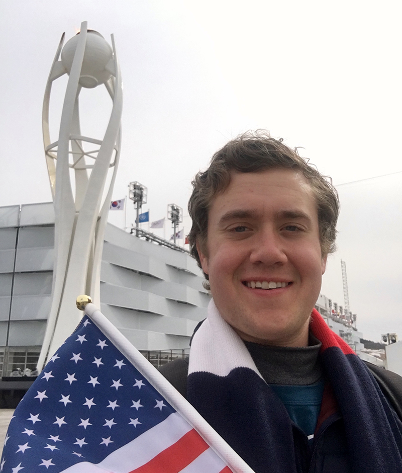 Ryan Roe and a statue of the Olympic flame in Pyeongchang.