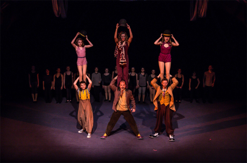 "The Actors Gymnasium performs ""Marie and Phil: A Circus Love Letter"" (2015). Nico Añón is the bottom left performer. Photo courtesy of The Actors Gymnasium."
