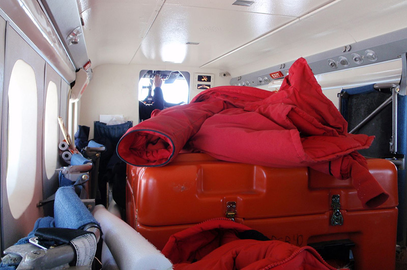 The inner cabin of a plane piled high with equipment