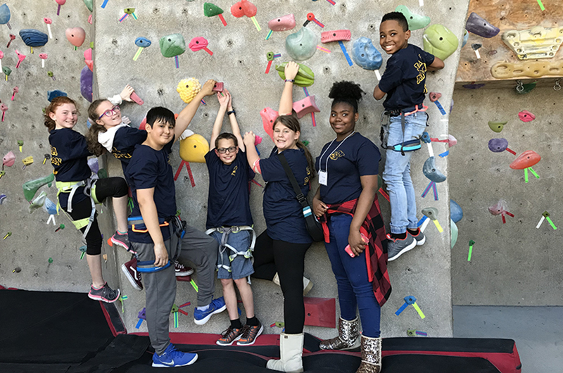 This group of 12-year-olds had fun at Drexel's climbing wall.