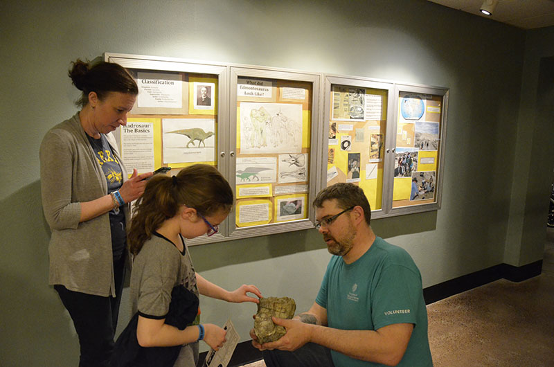 One child had the opportunity to touch and feel a real-life dinosaur fossil at the Academy of Natural Sciences during Drexel's Inspire a Child to Dream event.