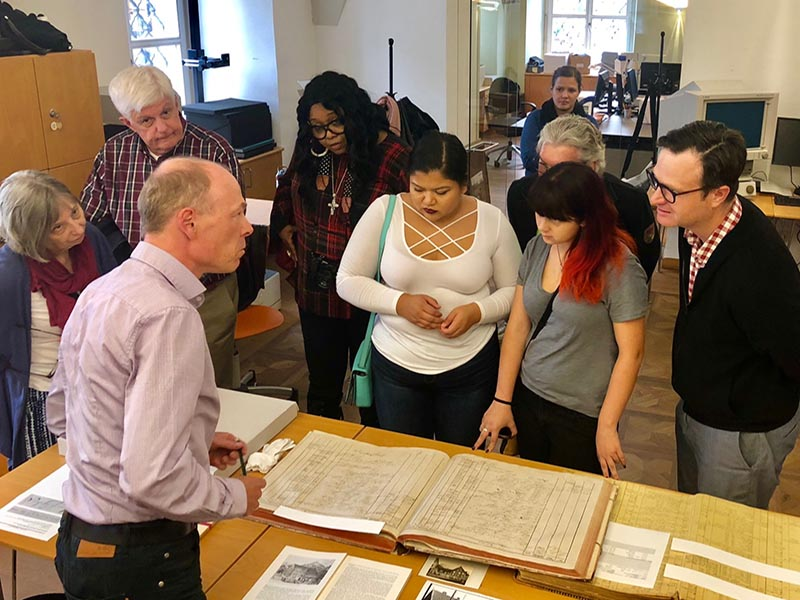 The Drexel delegation visiting the Dornbirn archives and examining records on Francis Martin Drexel.