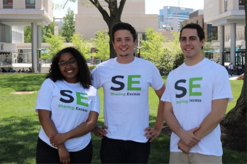 Evan Ehlers, center, a senior the Close School of Entrepreneurship, stands with members of his Sharing Excess startup.