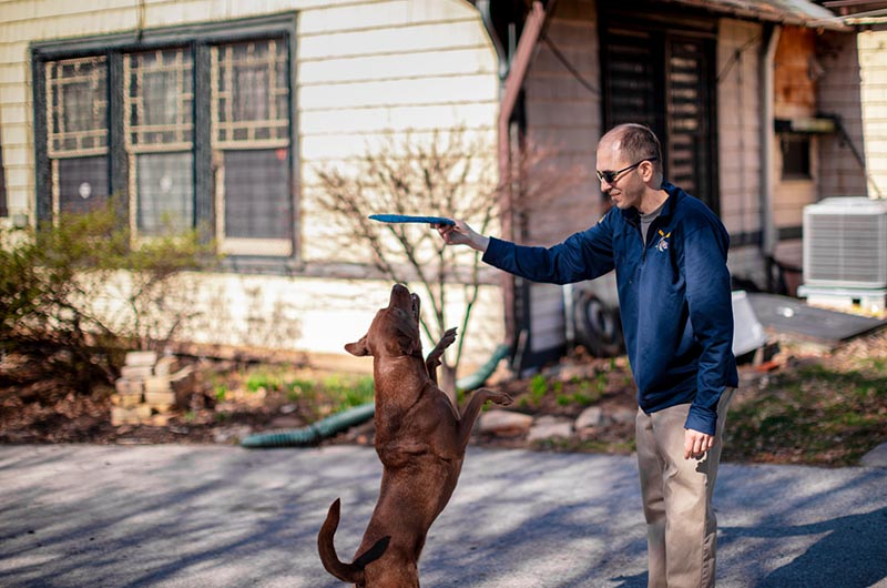 David Florio and his dog, Maddie, playing in the driveway of the Button.
