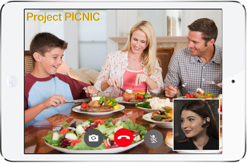 Smartphone screen image of family eating salads while video chatting female counselor for Project PICNIC
