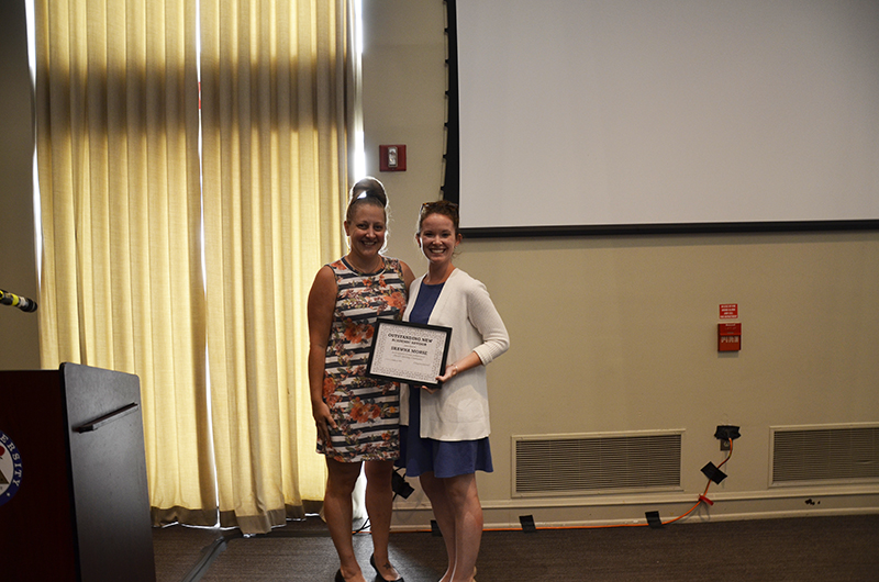 Janet Golon, left, and Shawna Morse. Golon presented Morse with the Outstanding New Advisor Award.