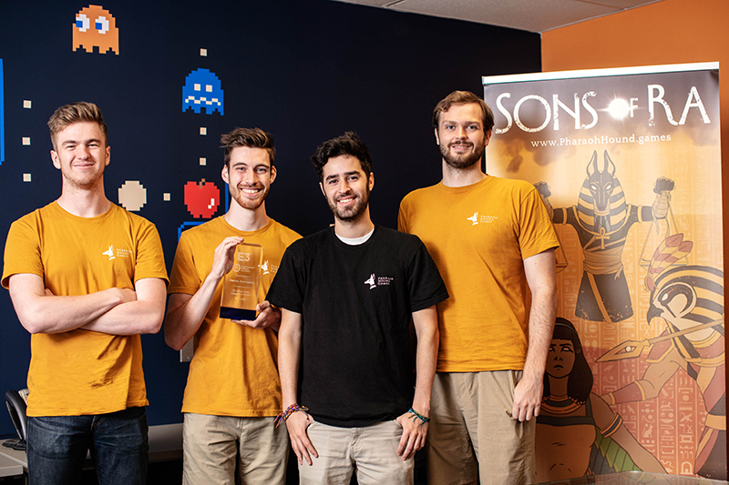 The Drexel students in Pharoah Hound Games pose with their E3 College Game Competition trophy. Left to right Joseph Brown, Jeff Mostyn, Michael Heffner and Mark Hurley. Photo credit: Charles Shan Cerrone.