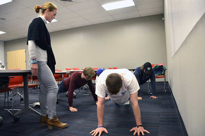 Kasey Manwaring, owner of GoalsFit, a personal training studio in Manayunk, does a pre- and post-class workout with the ENTP 225 students.