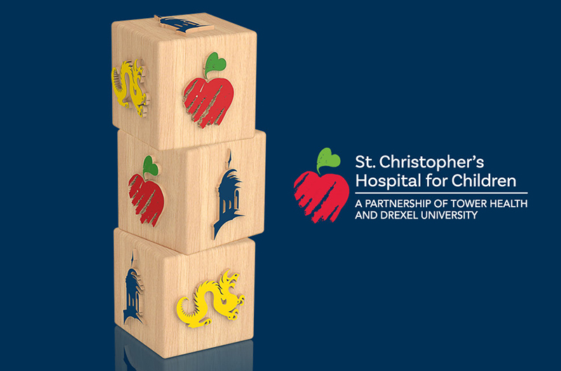 children's building blocks with Drexel, Tower Health and St. Christopher's logos
