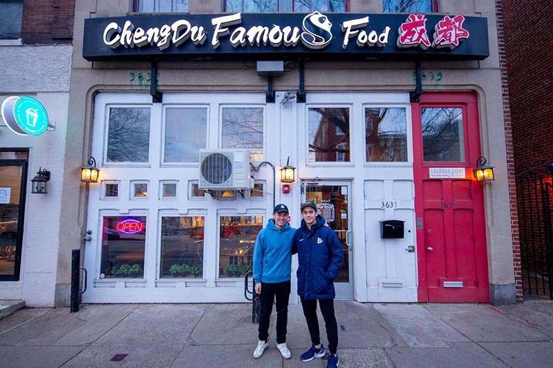 Mark Rao and Nathan Chan pose outside of Chengdu Famous Food.